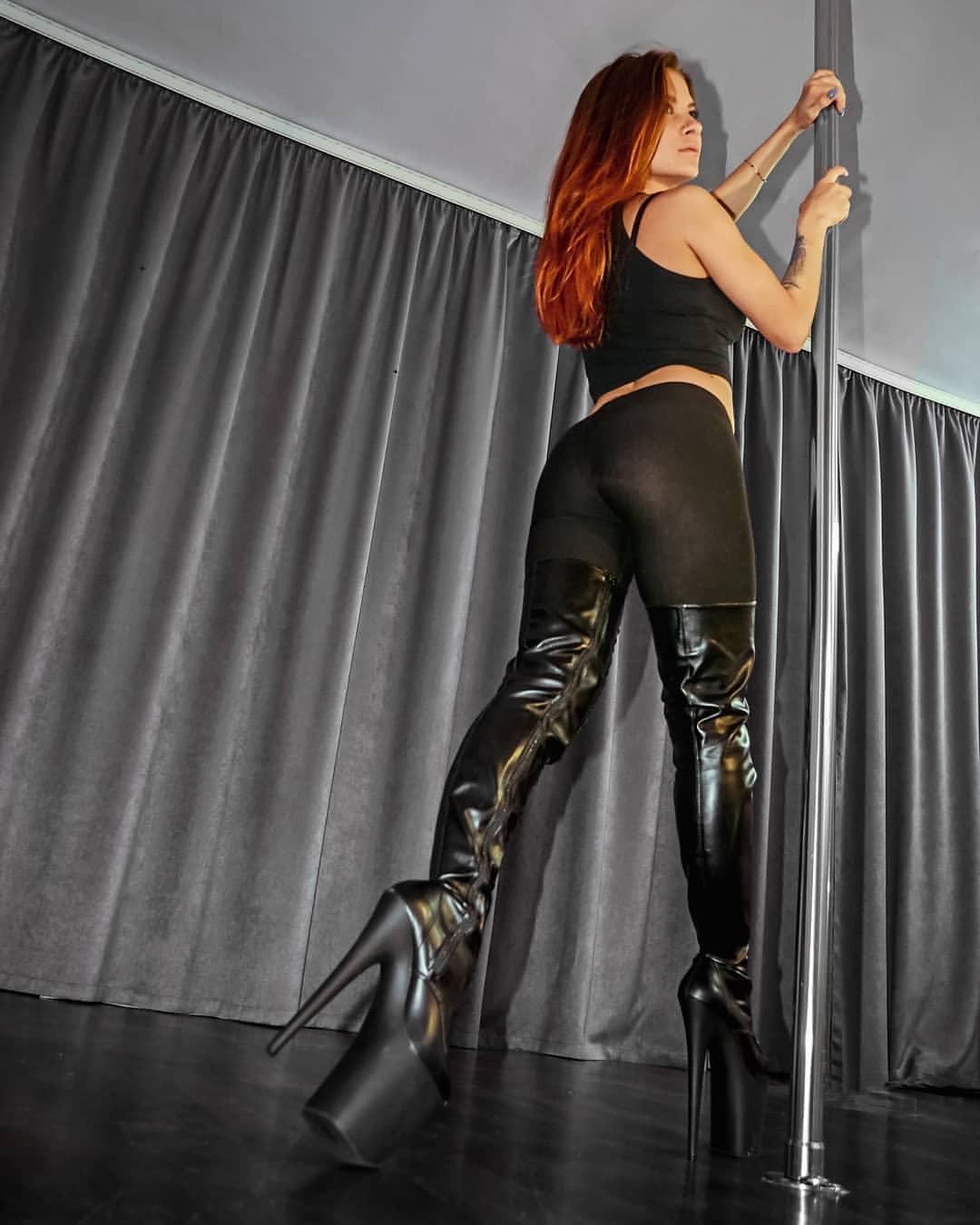 Popular exotic dancing shoes are high boots above the knees.